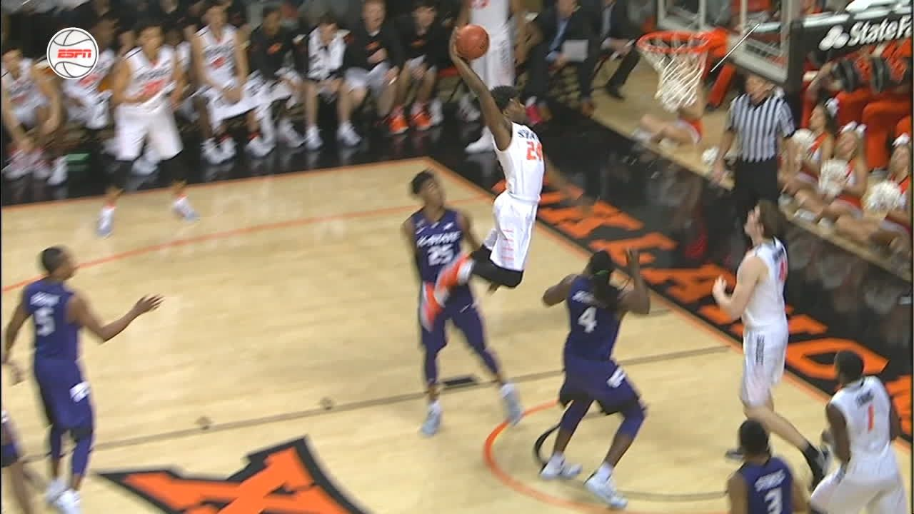 Oklahoma State's Dillard finishes with the powerful dunk ...