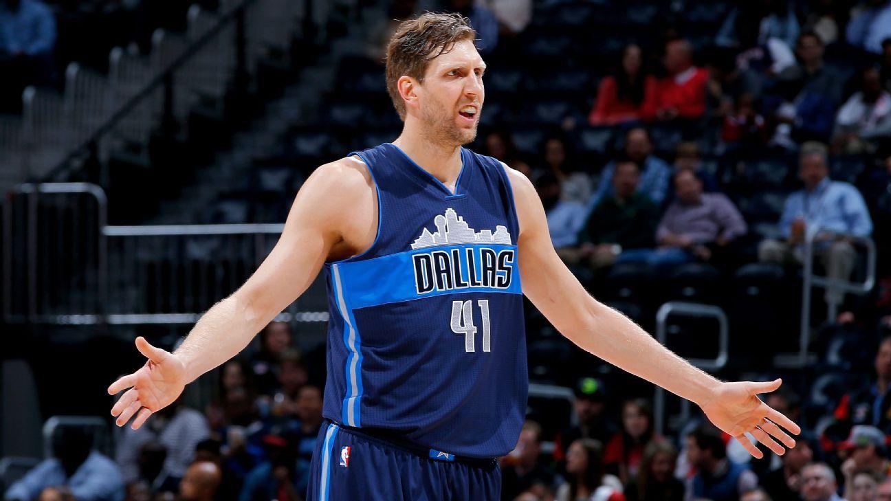 Dirk Nowitzki of Dallas Mavericks disagrees with Kareem Abdul