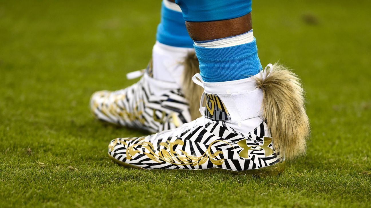 Cam Newton Makes Fashion Statement With Fox Tails On His