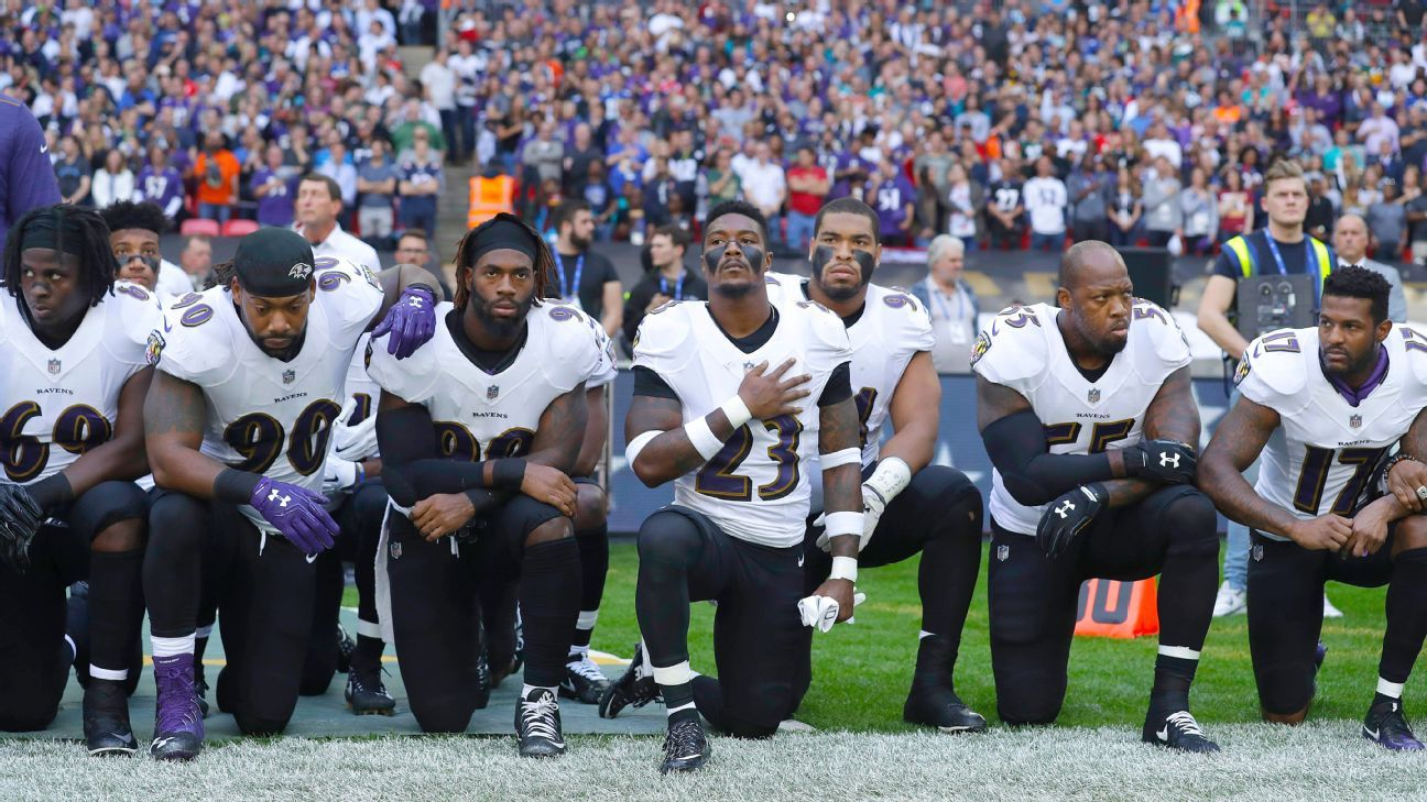 NFL players, coaches, owners kneel, lock arms during ...