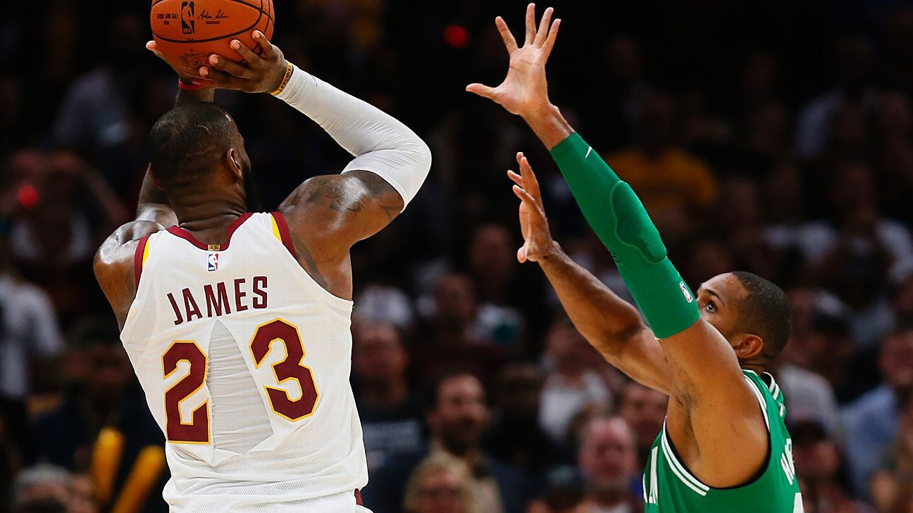 Nike studying why LeBron James' jersey split down middle in opener