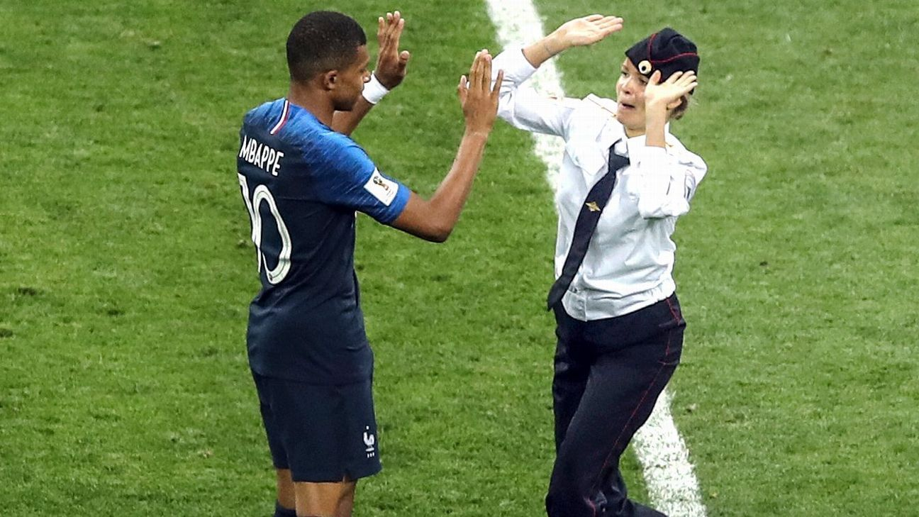 Pitch invaders briefly disrupt World Cup final in second half