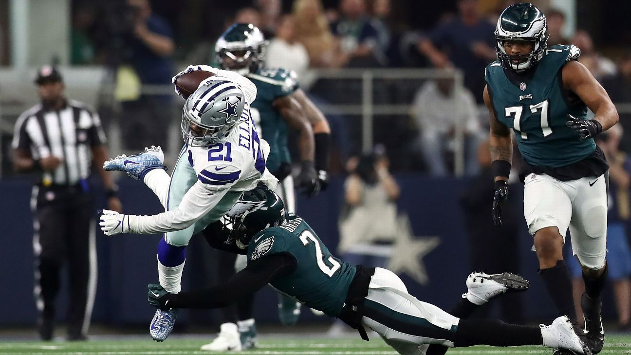 Ezekiel Elliott became the first offensive player to be flagged for violating the league's new helmet rule when the Cowboys running back lowered his head at the end of a 12-yard catch and run.