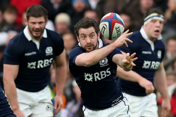 Greig Laidlaw offloads the ball against England
