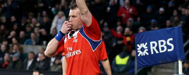 Referee Nigel Owens calls for a try