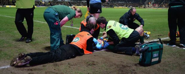 George North receives treatment on the pitch after being knocked out