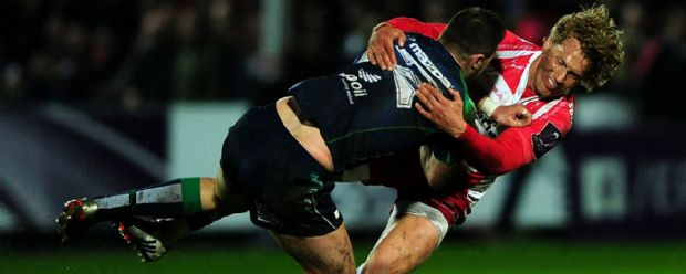 Connacht's Robbie Henshaw is tackled by Gloucester's Billy Twelvetrees