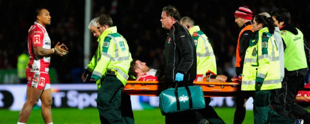 Gloucester's Ben Morgan is stretchered off with a fractured ankle during the Aviva Premieship clash with Saracens