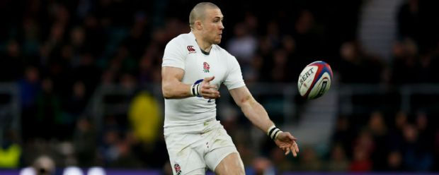 England fullback Mike Brown passes the ball