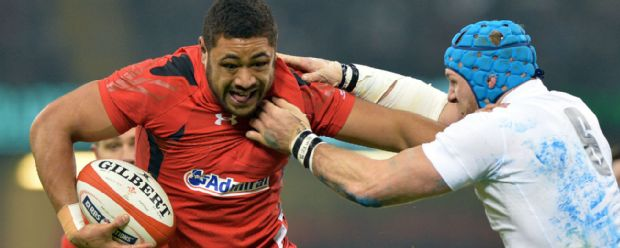 Wales number eight Taulupe Faletau holds off England's James Haskell