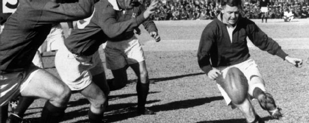 Bryn Meredith and Rees Williams of the British Lions rush T.A. Gentles, the Springbok scrum-half, in the first rugby test at Ellis Park, Johannesburg