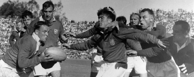 Bryn Meredith of the British Lions throws out a protective screen as British Lions' scrum-half Dicky Jeeps gets the ball from a line out