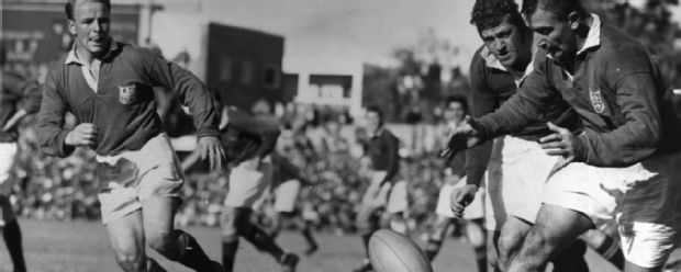 British Lions' Billy Williams is harassed by Salty Du Rand of the Springboks as he pases the ball to his scrum-half Dickie Jeeps