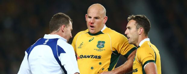 Stephen Moore chats to referee Nigel Owens during the defeat to New Zealand in the Bledisloe Cup.