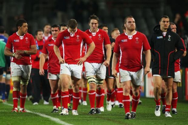 The Wales team walks off dejected after 2011 Rugby World Cup semifinal defeat to France