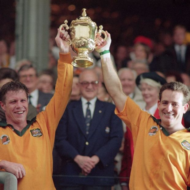 Nick Farr-Jones (left) and winger David Campese lift the Webb Ellis Cup