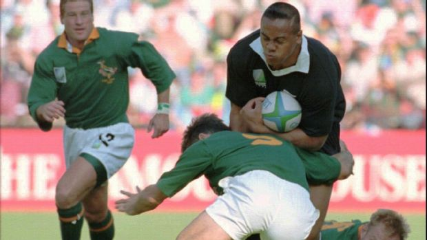 Jonah Lomu is tackled by Joost van der Westhuizen
