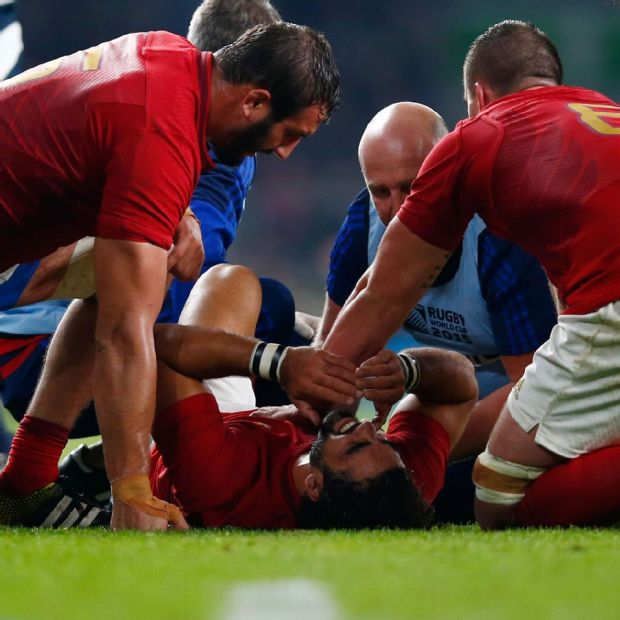 France wing Yoann Huget receives treatment for a serious knee injury sustained against Italy