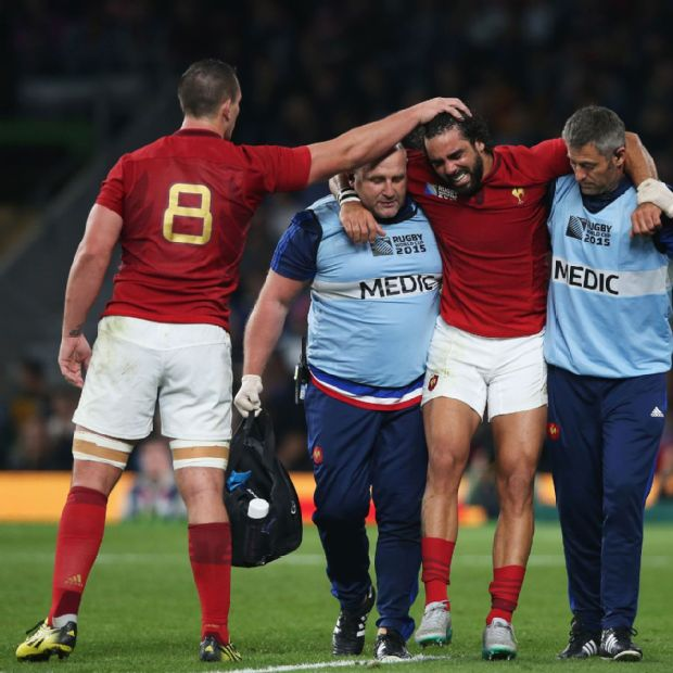 Louis Picamoles consoles Yoann Huget as the injured France wing is helped from the field