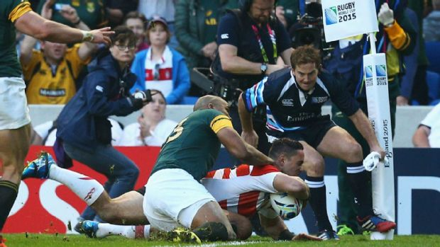 Karne Hesketh scores the match-winning try for Japan against South Africa