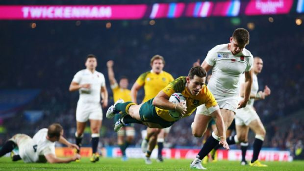 Bernard Foley of Australia goes over to score their second try against England