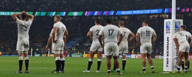 England players react after losing the 2015 Rugby World Cup Pool A match between England and Australia