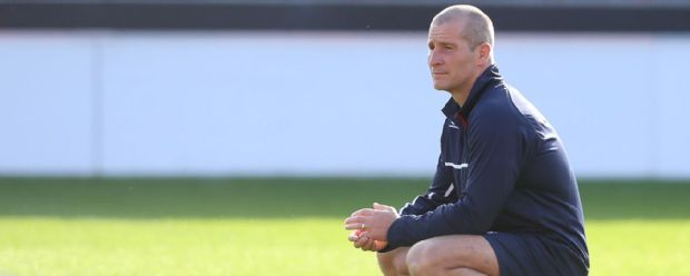 Stuart Lancaster looks on during England training