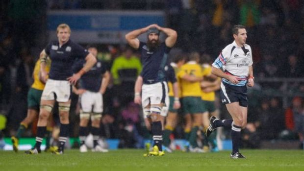 Referee Craig Joubert runs off the pitch after blowing the final whistle