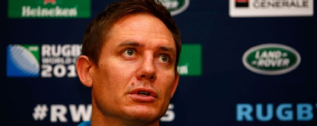 Australia assistant coach Stephen Larkham faces the press
