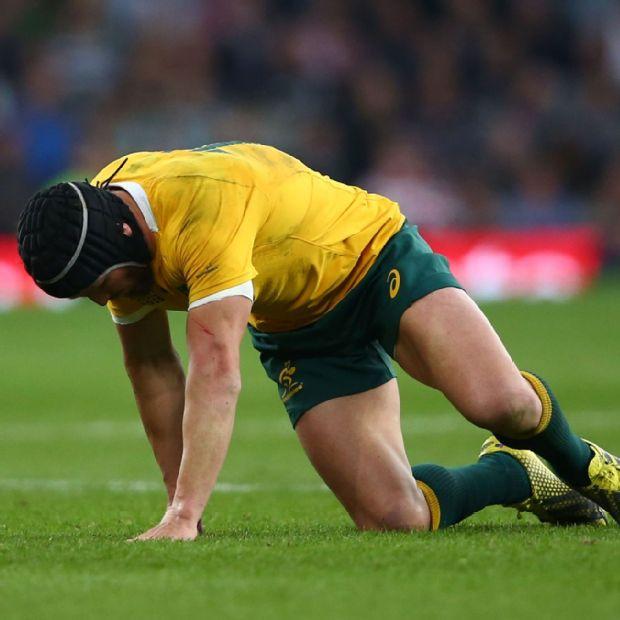 Matt Giteau tries to get up following an injury