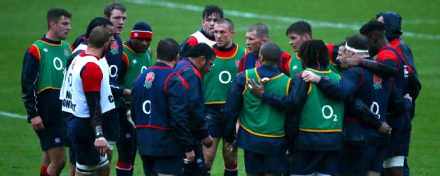 Dylan Hartley speaks with the England players during a training session at Pennyhill Park
