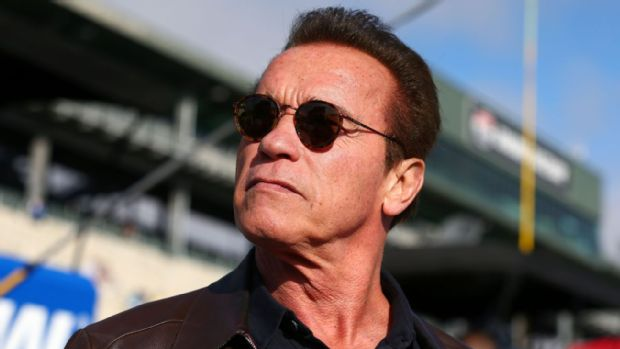 Actor and former governor of California Arnold Schwarzenegger stands on pit road prior to the NASCAR Sprint Cup Series