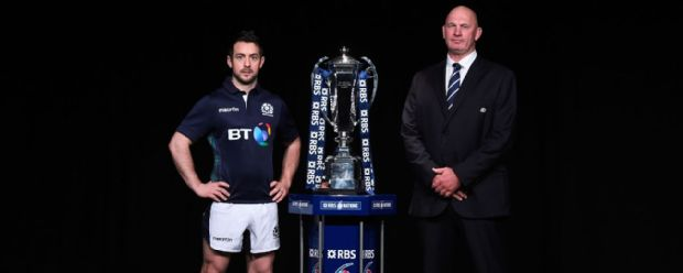 Greig Laidlaw, captain of Scotland and head coach Vern Cotter pose with the trophy during the RBS Six Nations launch