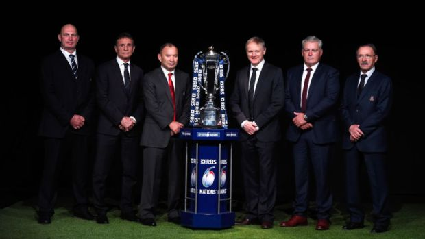 The head coaches line up with the Six Nations trophy