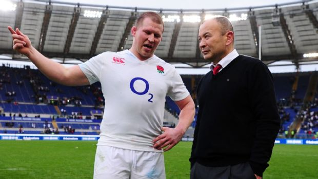 Eddie Jones the head coach of England speaks with England captain Dylan Hartley