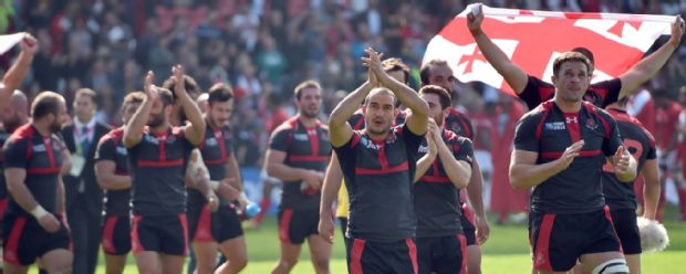 Georgia's players celebrate after winning a Pool C match of the 2015 Rugby World Cup between Tonga and Georgia