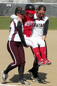 Sara Tucholsky got a lift from Central Washington's Liz Wallace, left, and Mallory Holtman in 2008.