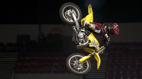 Whipmaster Chuck Carothers throws down during the Best Whip competition in the Rose Garden arena in Portland, Oregon.