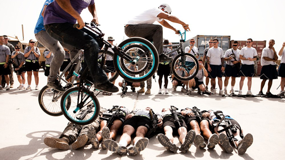 Bikes Over Baghdad athletes jumping over soldiers in Basrah, Iraq, on the first tour in September 2009.
