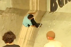 Brent Atchley snaps a melon at Burnside while onlookers gape at his style.
