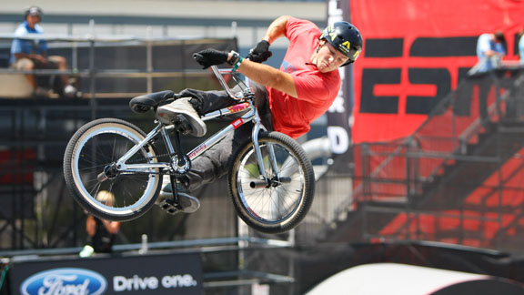 Gary Young, helmeted and looking back on the X Games 16 concrete park course.