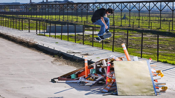 Chico blasts a backside flip from bank to bank on a crusty make-shift spot.