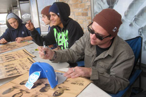 Neff team riders from left: Jordan Hoffart, Nick Merlino, Moose and Ryan Gallant sign autographs for the fans.