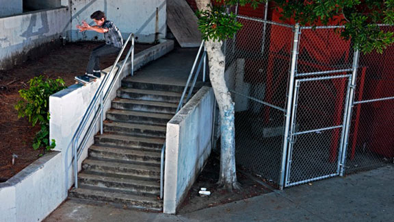 Donovan Piscopo ollies past the rail to dig into a tall 50-50.
