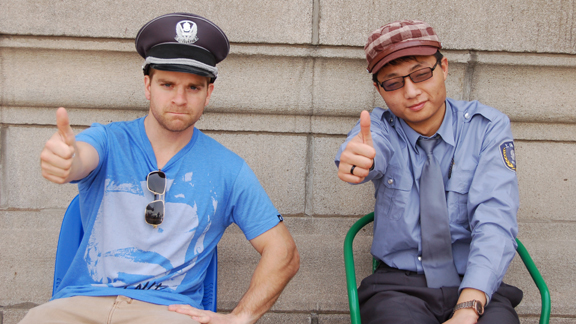 Brian Kachinsky and an Asian X Games security guard exchange hats in Shanghai, China.