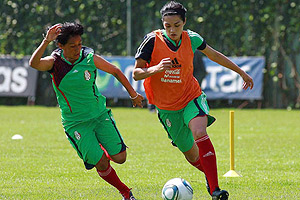 Priscilla Meza, right, was one of 10 Mexican-Americans who auditioned to play for El Tricolor in the Women's World Cup.