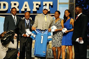 Ngum Suh, pictured with family at the NFL draft, took on her position as business manager for Ndamukong when he was entering his senior year at Nebraska and overwhelmed by the interest in his career.