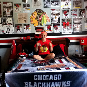 Stephanie Ballard relaxes in her Blackhawks fan cave.