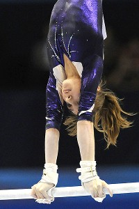 Russia's Victoria Komova won her first world title on the uneven bars.