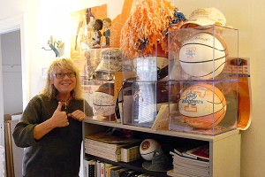 Raubyn's office is like a shrine to the Lady Vols, with posters adorning the walls and a case filled with autographed basketballs and bobblehead dolls.